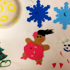 Foam shapes, glitter glue, paper and paint make for a fun parent-child activity.