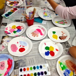 Moms & Kids Explore Painting At A Preschool Party. (All the photos that follow are from the party.)