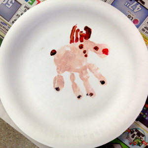 A Handprint Reindeer Assisted By Mom