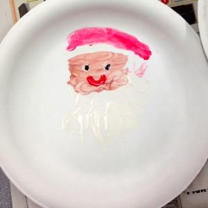 A Handprint Santa By Mom And Child